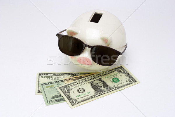 Blind piggy bank and US dollars Stock photo © dezign56