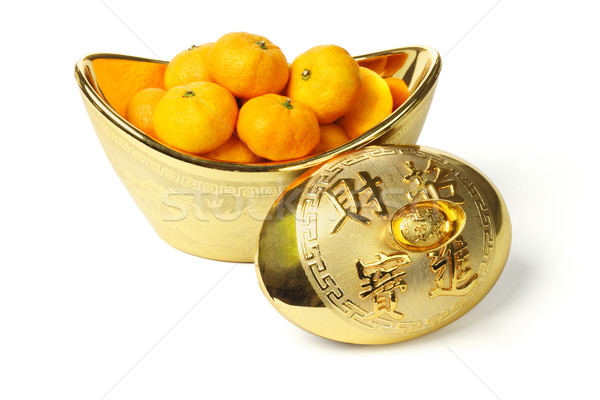 Mandarin oranges in gold ingot  Stock photo © dezign56