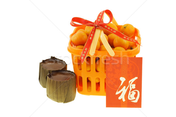 Gift basket of mandarin oranges and Chinese new year rice cakes  Stock photo © dezign56