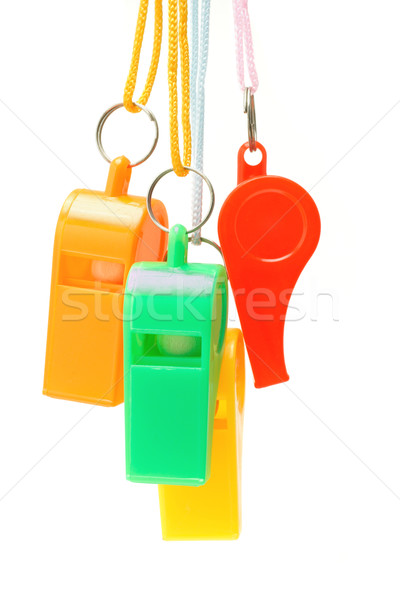 Suspended plastic whistles  Stock photo © dezign56