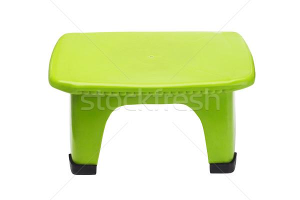 Zöld műanyag zsámoly kicsi izolált fehér Stock fotó © dezign56