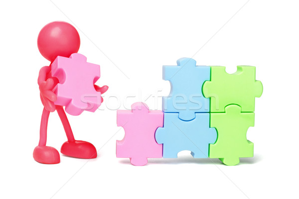 Faceless figurine and jigsaw puzzles Stock photo © dezign56