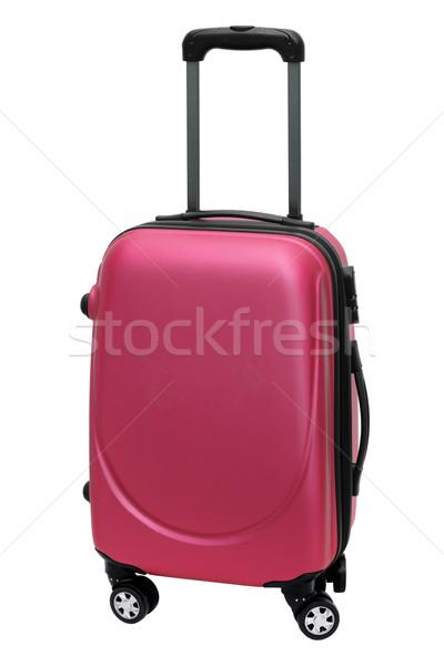 Kırmızı seyahat çanta tekerlekler ayakta beyaz Stok fotoğraf © dezign56