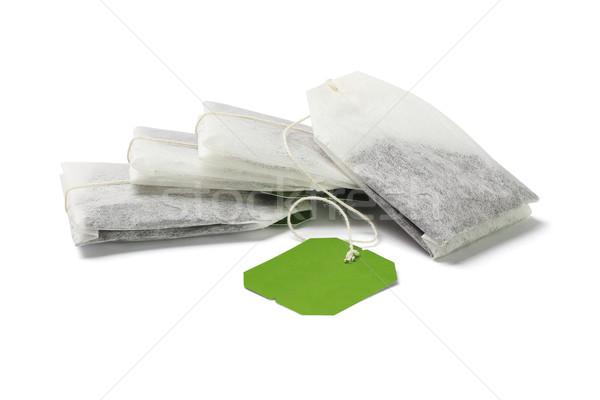 Zöld tea szatyrok boglya címke fehér ital Stock fotó © dezign56