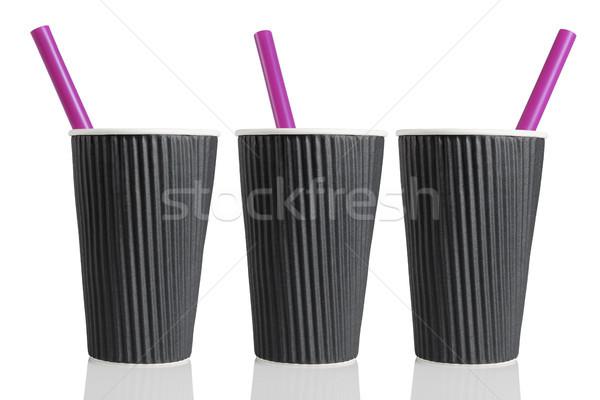 Három feketekávé csészék csetepaté színes műanyag Stock fotó © dezign56