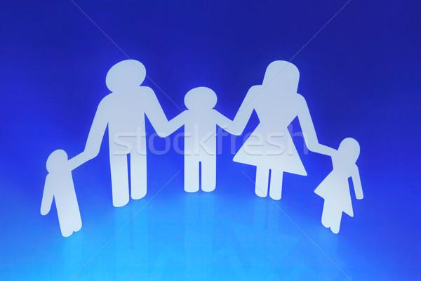 Familie papier keten holding handen Blauw hand Stockfoto © dezign56