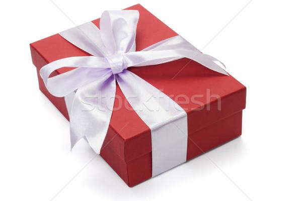 Vermelho caixa de presente arco fita branco aniversário Foto stock © dezign56