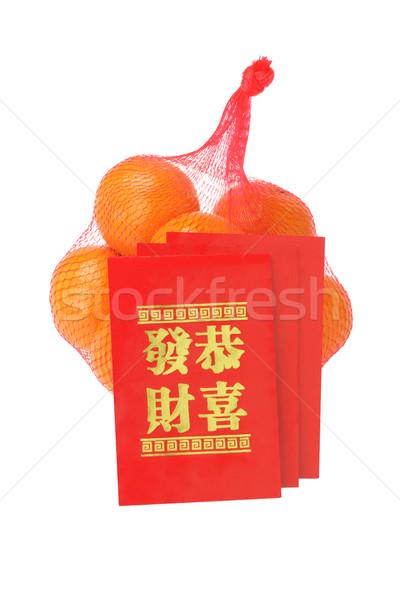 Kínai új év piros narancsok fehér gyümölcs táska Stock fotó © dezign56