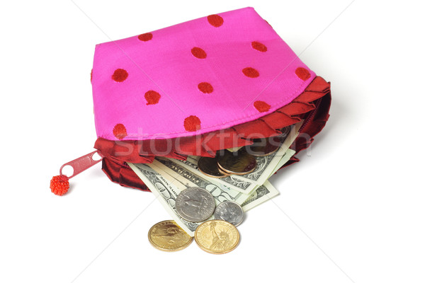 US notes and coins spilling out from pink purse  Stock photo © dezign56