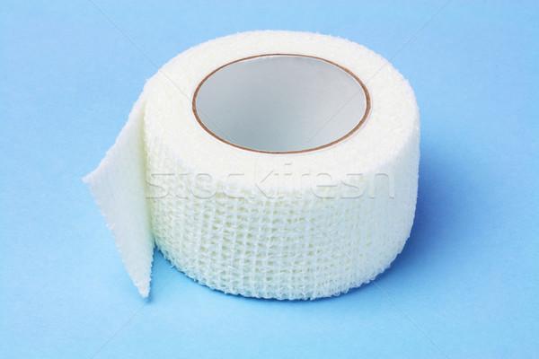 Beyaz elastik tıbbi bandaj mavi kumaş Stok fotoğraf © dezign56