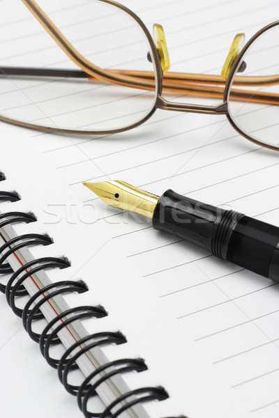 Eyeglasses and fountain pen on notebook Stock photo © dezign56