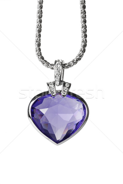 Silver pendant and blue heart shaped gemstone Stock photo © dezign56