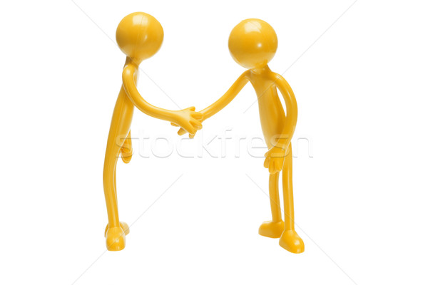 Toy rubber figurines shaking hands Stock photo © dezign56
