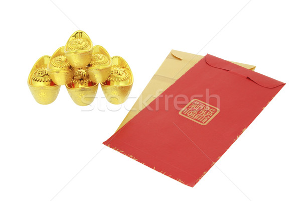 Chinese lunar New Year red packets and gold ingots Stock photo © dezign56