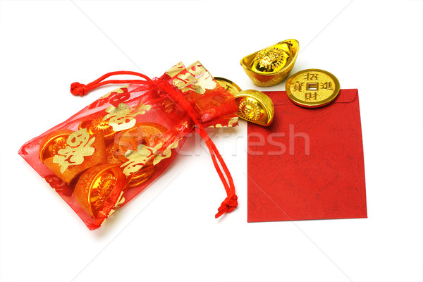 Gold ingots and coins in red sachet and red packet Stock photo © dezign56