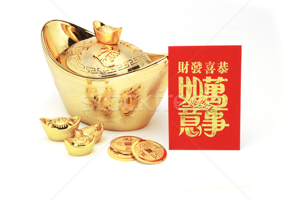 Chinese new year gold ingots and red packet Stock photo © dezign56