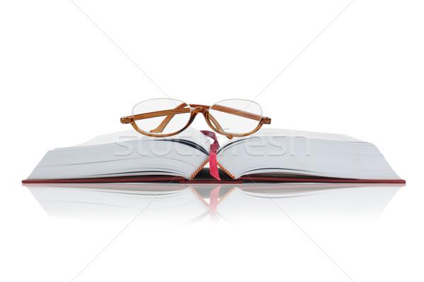 Szemüveg nyitott könyv olvasószemüveg nyitva keményfedeles könyv Stock fotó © dezign56