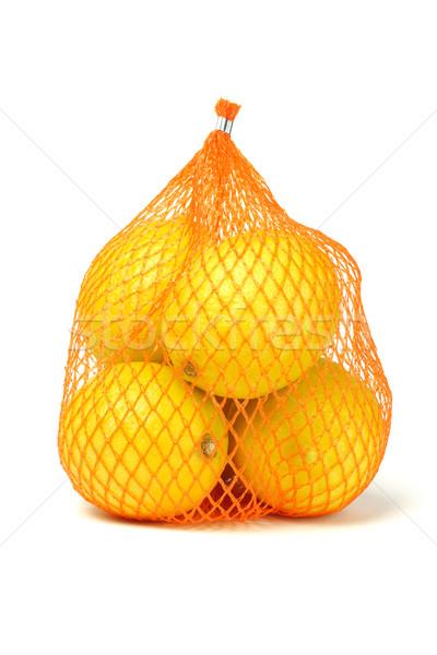 Lemons in plastic netting  Stock photo © dezign56