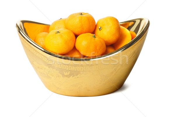 Mandarin oranges in gold ingot container  Stock photo © dezign56