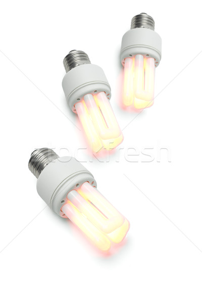 Glowing warm compact fluorescent light bulbs Stock photo © dezign56