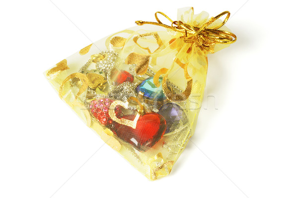 Colorful jewelry in gold pouch  Stock photo © dezign56