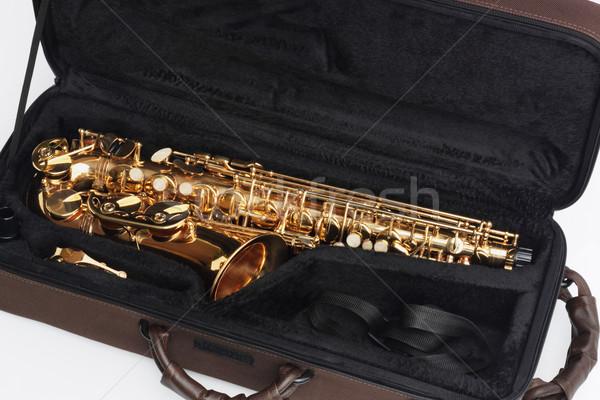 Saksofon açmak durum beyaz rüzgâr konteyner Stok fotoğraf © dezign56