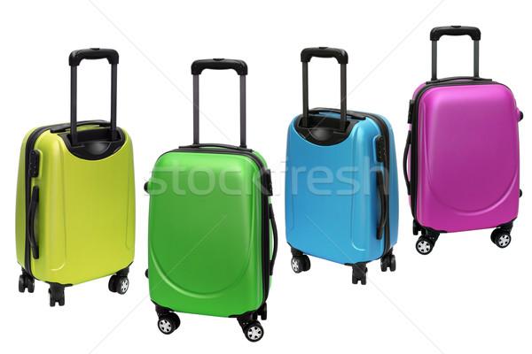 Renkli bagaj beyaz çanta kilitlemek tekerlek Stok fotoğraf © dezign56