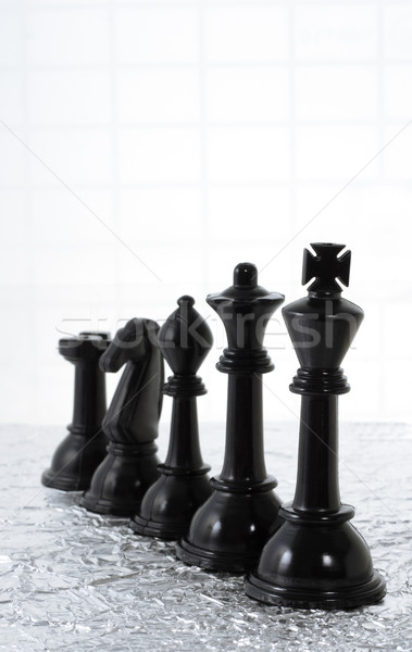 Row of black chess pieces Stock photo © dezign56
