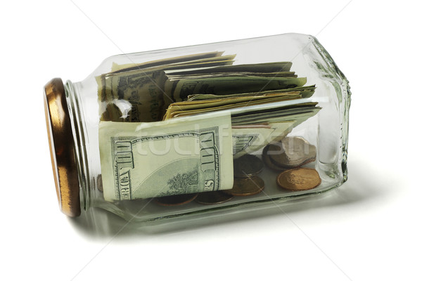 US Dollars and Coins in Glass Jar Stock photo © dezign56