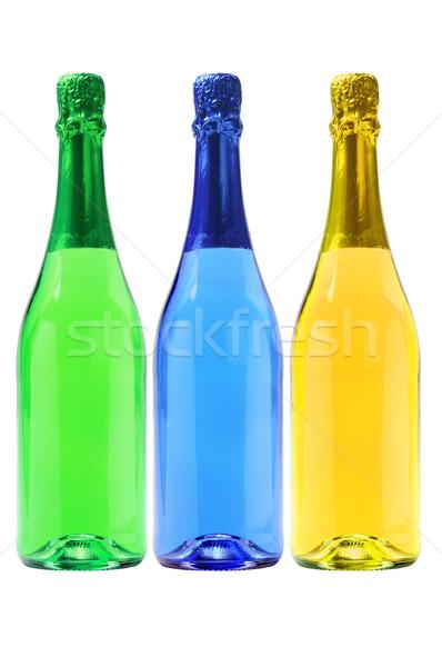Három üvegek szénsavas italok színes fehér Stock fotó © dezign56