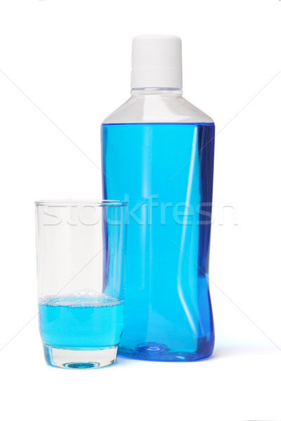 Plastic bottle and glass of mouthwash Stock photo © dezign56