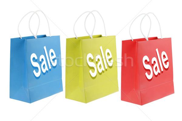 Színes bevásárlótáskák fehér kék csoport piros Stock fotó © dezign56