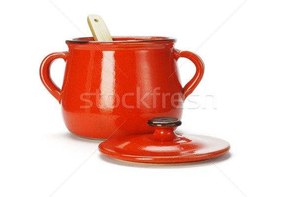 Open red clay pot with wooden ladle  Stock photo © dezign56