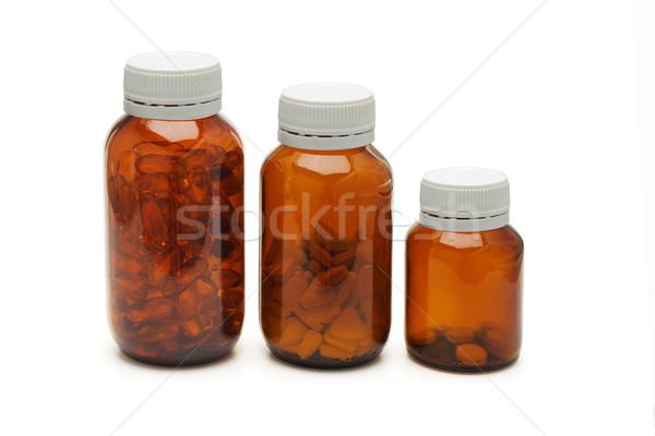 Three glass bottles of medicines Stock photo © dezign56