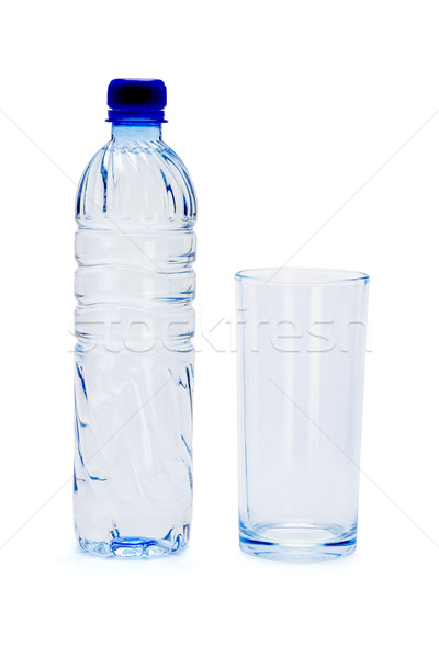 Bottle of mineral water and empty glass Stock photo © dezign56