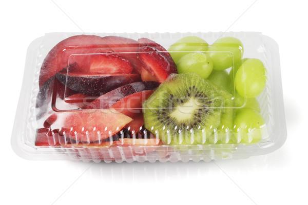 Vegyes vág gyümölcsök műanyag doboz fehér Stock fotó © dezign56