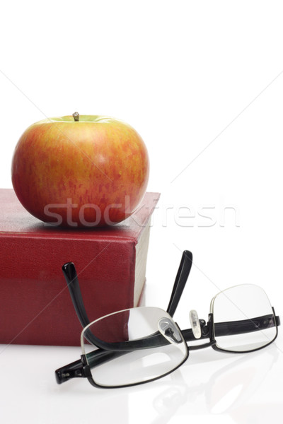Apple, reading glasses and book Stock photo © dezign56