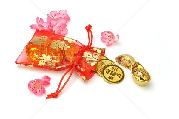 Gold ingots and coins in red sachet  Stock photo © dezign56