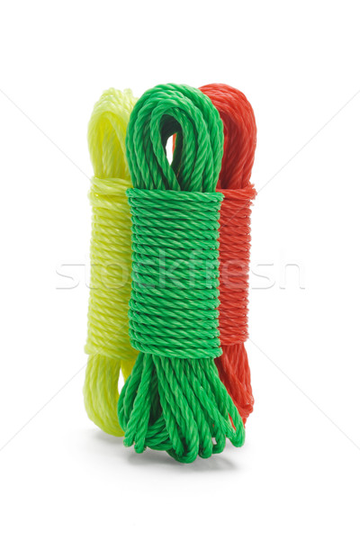 Three bundles of colorful nylon ropes Stock photo © dezign56