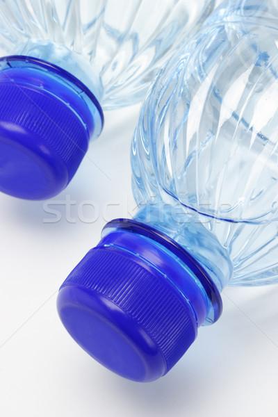 ásványvíz műanyag üvegek közelkép ital üveg Stock fotó © dezign56