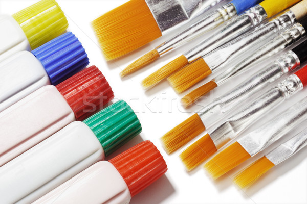 Tubes of color paints and brushes Stock photo © dezign56