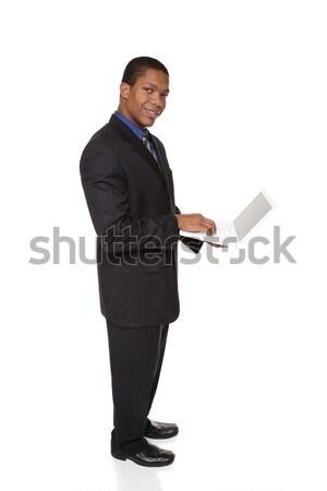 üzletember laptop izolált teljes alakos stúdiófelvétel néz Stock fotó © dgilder