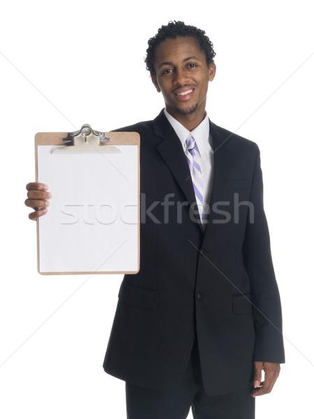 Empresário clipboard isolado sorridente Foto stock © dgilder