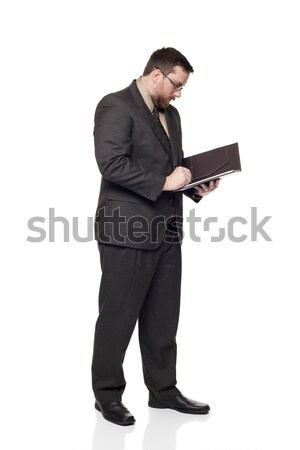 Vista lateral caucasiano empresário escrita bloco de notas isolado Foto stock © dgilder