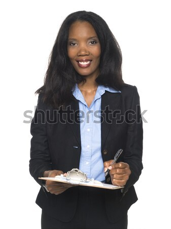 businesswoman - writing on clipboard Stock photo © dgilder