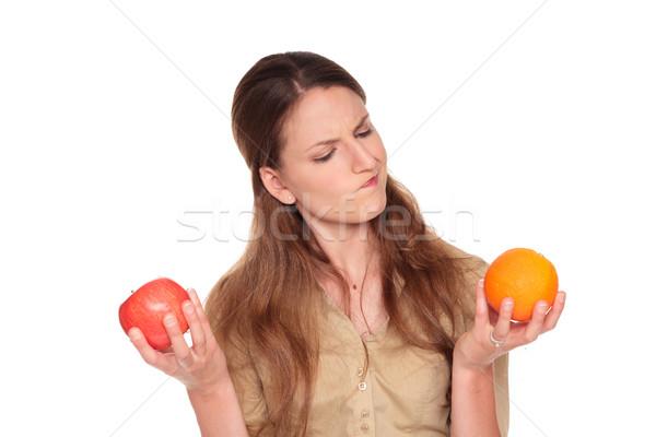 деловая женщина яблоко против оранжевый изолированный Сток-фото © dgilder