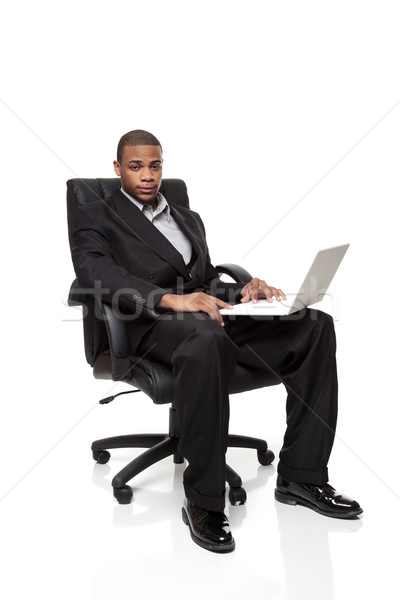 African American businessman sitting in chair with laptop Stock photo © dgilder