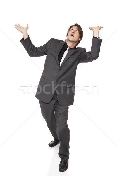 businessman - holding up Stock photo © dgilder