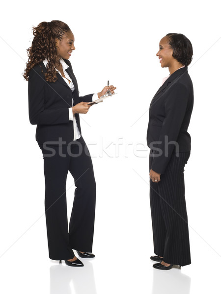 Interview vorm zakenvrouw beneden antwoorden Stockfoto © dgilder