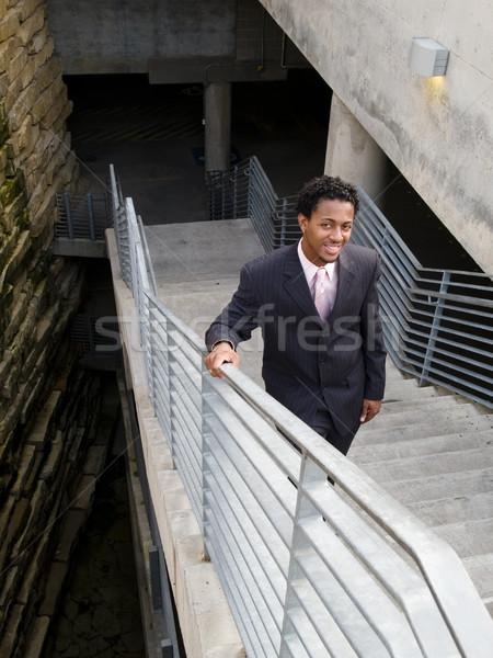 Sorridente empresário escada três peça terno Foto stock © dgilder